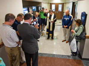 Fr. Foster says a blessing at the DNA Learning Center dedicatio