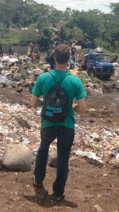 Mark Brahier observes activity in the La Joya garbage dump outside of Granada, Nicaragua
