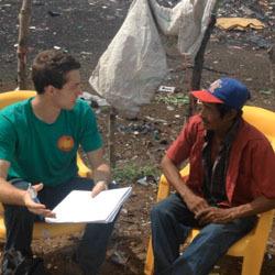 Mark Brahier interviews a garbage dump worker in Nicaragua