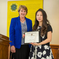 Mary Galvin presents Diane Choi with the Dean's Research Award