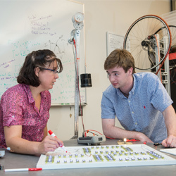 Prof. Abigail Mechtenberg and student Luke Maillie discuss their gravity light project