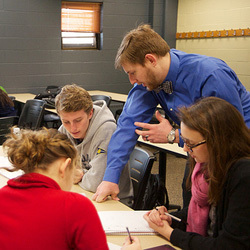 Brian Shourd works with a group in his Calculus III class